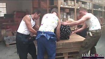 Busty secretary Devon Lee is gangbanged by two horny guys