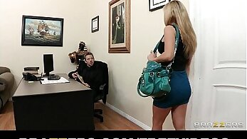 Busty brunette seduced by hotel secretary