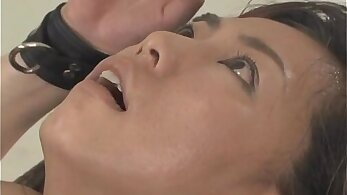 asian babe with sex machine on the bed