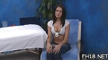 Busty masseuse giving massage to client
