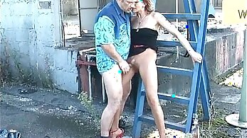 Brunette MILF fucks a young chap outdoors