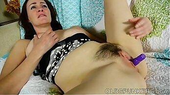 Artemina Moon fondles her brunette pussy
